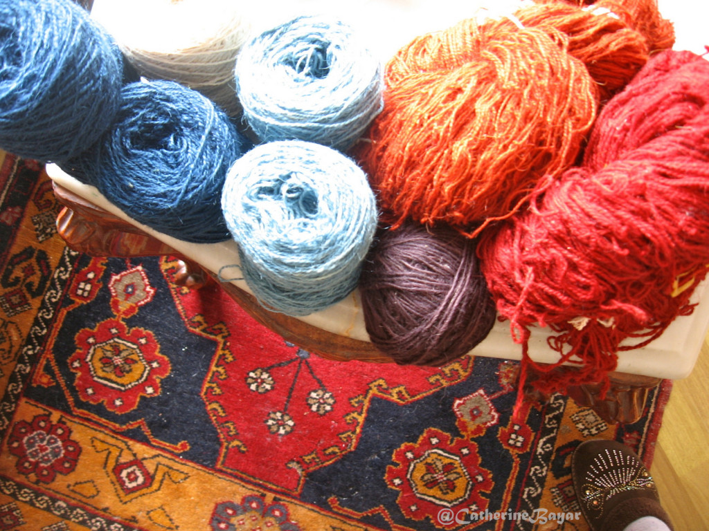 The hand dyed wools to create these handcrafts, whether carpet or handknit